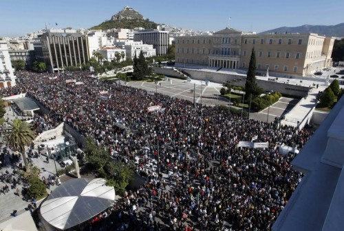 People walk past the Greek parliament during an anti-austerity rally in Athens' Syntagma square